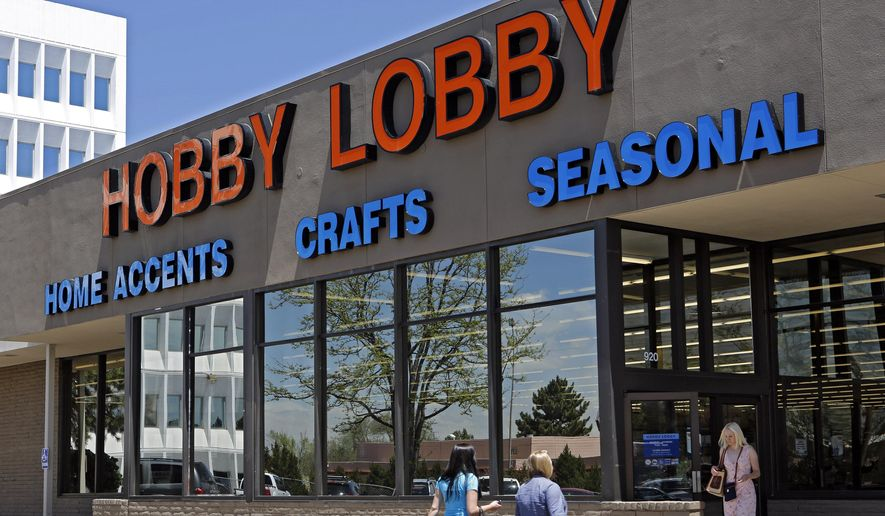 This May 22, 2013, file photo shows customers at a Hobby Lobby store in Denver. The Supreme Court says corporations can hold religious objections that allow them to opt out of the new health law requirement that they cover contraceptives for women.  (AP Photo/Ed Andrieski, File)