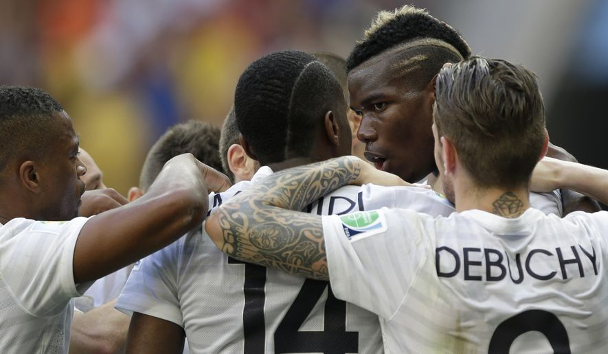 France's Paul Pogba, second from right, celebrates with teammates after scoring his team's first goal sduring the World Cup round of 16 soccer match between France and Nigeria at the Estadio Nacional in Brasilia, Brazil, Monday, June 30, 2014. (AP Photo/Ricardo Mazalan)