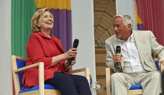 "Hillary Clinton enjoys a laugh with Aspen Institute CEO Walter Isaacson during a conversation Monday, June 30, 2014, at the Aspen Ideas Festival.  She decried the Supreme Court's ""Hobby Lobby decision,"" described some of the tough choices she had to make as Secretary of State but got the most applause when she spoke about women's issues.  (AP Photo/The Aspen Times, Aubree Dallas)"