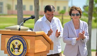 CORRECTS IDENTITY TO STATE SEN. EDDIE LUCIO JR., INSTEAD OF STATE REP. EDDIE LUCIO III - Texas state Sen. Eddie Lucio Jr., left, walks with U.S. House Minority Leader Nancy Pelosi after a news conference on Saturday, June 28, 2014, in Brownsville, Texas. Pelosi said during a visit to the U.S.-Mexico border Saturday that she holds little hope that Congress will pass comprehensive immigration reform this year. (AP Photo/The Brownsville Herald, Miguel Roberts)