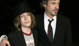 FILE - In this March 1, 2007 file photo, Robert Downey Jr. and his son Indio arrive at a premiere in Los Angeles. Authorities say Indio, the 20-year-old son of actor Robert Downey, Jr. is out on bail after being arrested with what deputies believe was cocaine Sunday, June 30, 2014, after a car he was in was pulled over in West Hollywood. Downey was released shortly after 9 p.m. on $10,250 bail. (AP Photo/Reed Saxon,File)