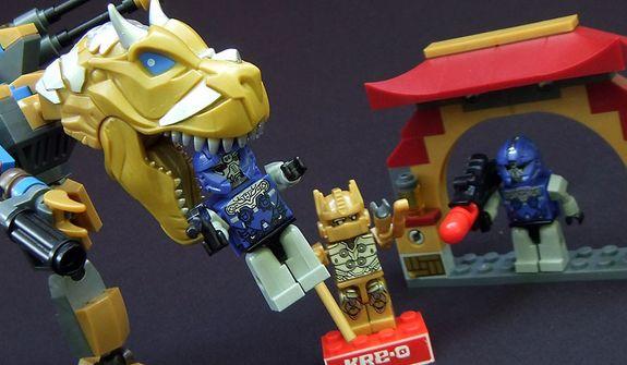 Hasbro's Kre-O Transformers Grimlock Street Attack set features a Dinobot attracted to a tasty Vehicon minifigure. (Photo by Joseph Szadkowski/The Washington Times)