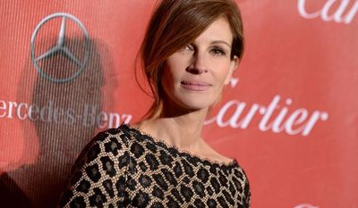FILE - In this Jan. 4, 2014 file photo, Julia Roberts arrives at the Palm Springs International Film Festival Awards Gala at the Palm Springs Convention Center, in Palm Springs, Calif.  The Los Angeles coroner's office is investigating the death  of Nancy Motes, 37, the half-sister of actors Julia and Eric Roberts. Motes was found dead in a Los Angeles home on Sunday, Feb. 9, 2014. (Photo by Jordan Strauss/Invision/AP, File)
