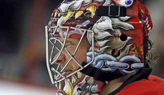Carolina Hurricanes goalie Justin Peters (35) watches play and the other end of the ice during the first period of an NHL hockey game against the Anaheim Ducks in Raleigh , N.C., Friday, Nov. 15, 2013. (AP Photo/Karl B DeBlaker)