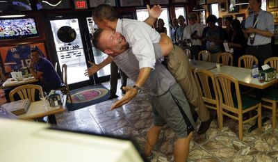 FILE - In this Sept. 9, 2012 file photo, President Barack Obama is picked-up and lifted off the ground by Scott Van Duzer, left, owner of Big Apple Pizza and Pasta Italian Restaurant during an unannounced stop in Ft. Pierce, Fla. Campaign 2012 is rich with images that conjure the seriousness and silliness that unfold side-by-side in any presidential race. It's not everyone who gets to hoist a president like a sack of potatoes. Van Duzer sent the president airborne with a giant bear hug when Obama stopped by his restaurant in Fort Pierce, (AP Photo/Pablo Martinez Monsivais, File)