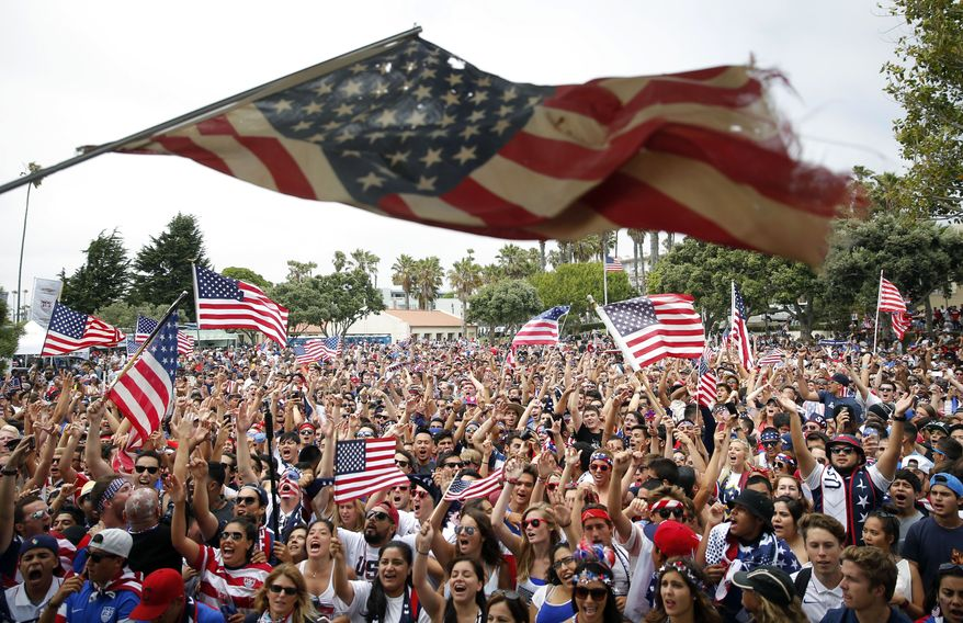 United States fans cheer while watching the World Cup soccer match between the U.S. and Belgium at a viewing party on Tuesday, July 1, 2014, in Redondo Beach, Calif. Belgium won 2-1 in extra time. (AP Photo/Jae C. Hong)