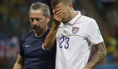 United States' Fabian Johnson (23) leaves the pitch after being injured during the World Cup round of 16 soccer match between Belgium and the USA at the Arena Fonte Nova in Salvador, Brazil, Tuesday, July 1, 2014. (AP Photo/Felipe Dana)
