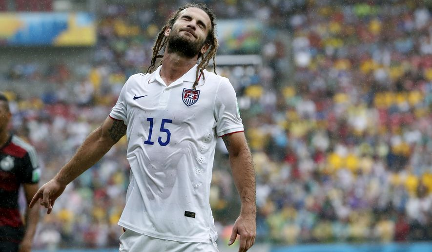 United States' Kyle Beckerman closes his eyes during the group G World Cup soccer match between the USA and Germany at the Arena Pernambuco in Recife, Brazil, Thursday, June 26, 2014. (AP Photo/Matthias Schrader)