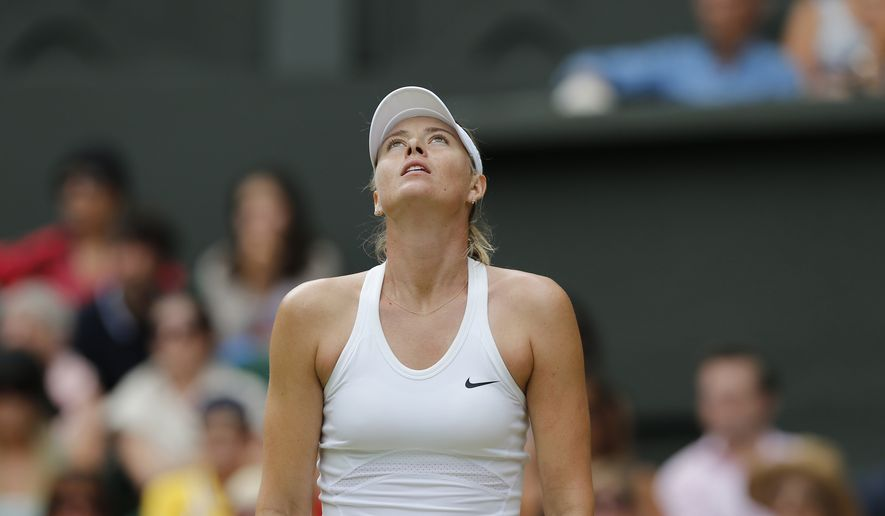 Maria Sharapova of Russia looks dejected after losing a point to Angelique Kerber of Germany during their women's singles match at the All England Lawn Tennis Championships in Wimbledon, London, Tuesday, July 1, 2014. (AP Photo/Ben Curtis)