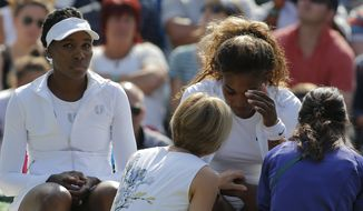 Court officials talk to Serena Williams and Venus Williams, left, of the U.S as they retire after 3 games from their women's doubles match against Kristina Barrois of Germany and Stefanie Voegele of Switzerland at the All England Lawn Tennis Championships in Wimbledon, London, Tuesday July 1, 2014. (AP Photo/Pavel Golovkin)