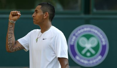 Nick Kyrgios of Australia celebrates after winning a point against Rafael Nadal of Spain during their men's singles match on Centre Court at the All England Lawn Tennis Championships in Wimbledon, London, Tuesday, July 1, 2014. (AP Photo/Ben Curtis)