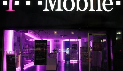 "FILE - An Oct. 19, 2012, file photo  is of a T-Mobile store  in New York.  The Federal Trad Commission  Tuesday July 1, 2014, is alleging that T-Mobile USA, Inc., made ""hundreds of millions"" of dollars off its customers through bogus charges.  . (AP Photo/Mark Lennihan, file)"
