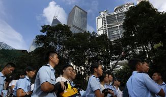 Protesters are arrested by police officers outside HSBC headquarters in the financial district in Hong Kong Wednesday, July 2, 2014, following a huge rally to show their support for democratic reform and oppose Beijing's desire to have the final say on candidates for the chief executive's job. More than 500 arrested from sit-in following massive Hong Kong pro-democracy rally. (AP Photo/Vincent Yu)