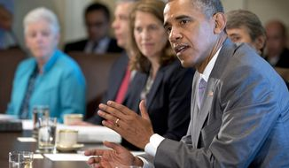President Barack Obama speaks to the media during a meeting with his cabinet members in the Cabinet Room of the White House in Washington,  Tuesday, July 1, 2014. From left are, Environmental Protection Agency (EPA)  Administrator Gina McCarthy, Education Secretary Arne Duncan, Health and Human Services Secretary Sylvia Mathews Burwell, Interior Secretary Sally Jewell, and the president. (AP Photo/Jacquelyn Martin)