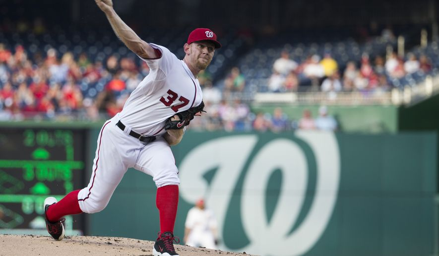 Washington Nationals starting pitcher Stephen Strasburg delivers a pitch to the Colorado Rockies during the first inning of a baseball game at Nationals Park, on Tuesday, July 1, 2014, in Washington. (AP Photo/Evan Vucci)