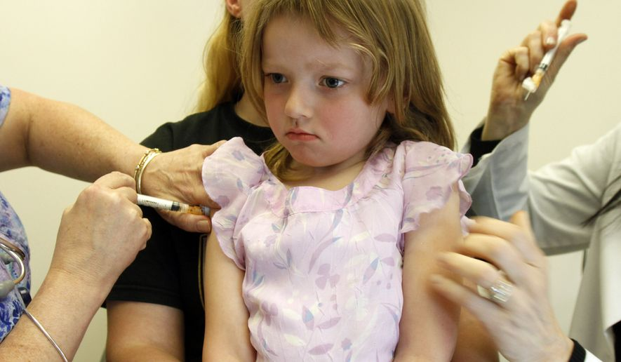 In this April 20, 2012, file photo, Holly Ann Haley, 4, gets two vaccinations at the doctor's office in Berlin, Vt. (AP Photo/Toby Talbot, File)
