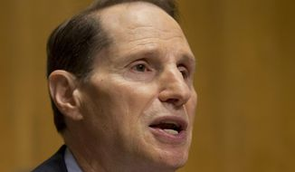 """Sen. Ron Wyden, Oregon Democrat, warns that Section 702 programs can amount to warrantless """"backdoor searches"""" of Americans' communications/ (AP Photo/Jacquelyn Martin, File)"""