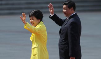 FILE - In this Thursday, June 27, 2013 file photo, South Korean President Park Geun-hye, left, and her Chinese counterpart Xi Jinping wave during a welcoming ceremony outside the Great Hall of the People in Beijing. Xi Jinping's first visit to the Korean Peninsula as China's president is to Seoul, not Pyongyang, meaning that North Korea's best friend has snubbed it for its most bitter rival. A flurry of recent rocket and missile tests, the latest on Wednesday, has made the North's displeasure crystal clear.  (AP Photo/Wang Zhao, Pool, File) **FILE**