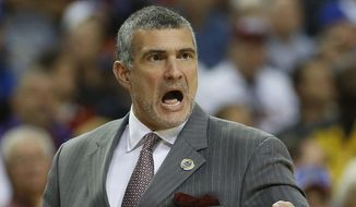 FILE - In this March 12, 2014 file photo, South Carolina head coach Frank Martin speaks to players during a college basketball game against Auburn in the Southeastern Conference tournament. Martin feels closer than ever to turning the corner with South Carolina and believes the Gamecocks are working hard this offseason to make that happen. (AP Photo/John Bazemore, File)