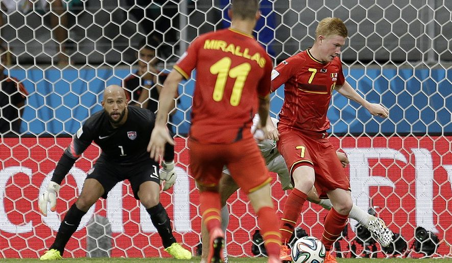 United States' goalkeeper Tim Howard watches as Belgium's Kevin De Bruyne (7) dribbles the ball before  scoring his side's first goal in extra time during the World Cup round of 16 soccer match between Belgium and the USA at the Arena Fonte Nova in Salvador, Brazil, Tuesday, July 1, 2014. (AP Photo/Natacha Pisarenko)