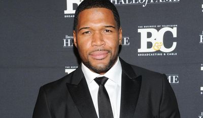 """FILE - This Oct. 28, 2013 file photo shows former professional football player Michael Strahan, co-host of """"Live with Kelly and Michael,"""" attending the 23rd Annual Broadcasting & Cable Hall of Fame Awards in New York. Strahan has made good on reports that he is joining """"Good Morning America"""" by paying a visit to the ABC breakfast show on Tuesday, April 15, 2014. The former football star and current co-host with Kelly Ripa of """"Live With Kelly and Michael"""" will join """"Good Morning America"""" part-time. (Photo by Evan Agostini/Invision/AP, File)"""