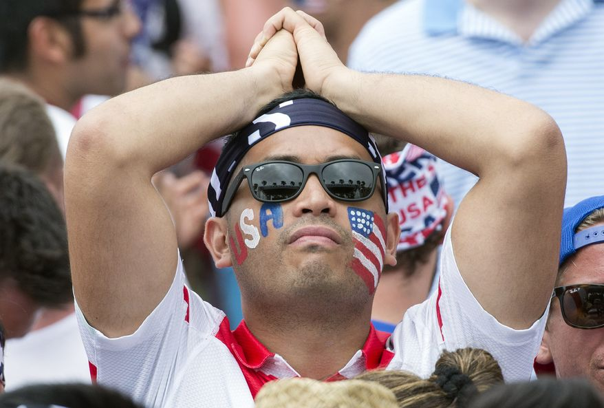 A U.S. soccer fan shows his disappointment at a World Cup soccer viewing party in Redondo Beach, Calif., after a they lost 2-1 to Belgium Tuesday, July 1, 2014. (AP Photo/The Orange County Register, Kyusung Gong)