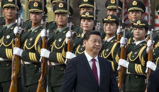 Chinese President Xi Jinping walks near a guard of honor at a welcome ceremony for Myanmar President Thein Sein in Beijing, China, June 27, 2014. (AP Photo/Ng Han Guan) ** FILE **
