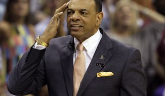 FILE - In this May 27, 2013 file photo, Memphis Grizzlies coach Lionel Hollins gestures during the first half in Game 4 of the Western Conference finals NBA basketball playoff series  against the San Antonio Spurs, in Memphis, Tenn. The Brooklyn Nets say they have reached an agreement in principle with Hollins to become their coach, moving quickly after the departure of Jason Kidd. The deal with the former Grizzlies coach comes just two days after they made a trade with Milwaukee to allow Kidd out of his contract so the Bucks could hire him. The Nets then met with Hollins on Monday night and again Tuesday before agreeing to the deal on Wednesday, July 2, 2014. (AP Photo/Danny Johnston, File)