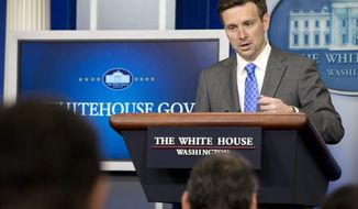 White House press secretary Josh Earnest speaks during the daily briefing in the Brady Press Briefing Room of the White House, Wednesday, July 2, 2014, in Washington. Earnest spoke about the death of 17-year-old Palestinian Mohammed Abu Khdeir, and answered questions on topics including about the influx of unaccompanied minors at the border. (AP Photo/Jacquelyn Martin)