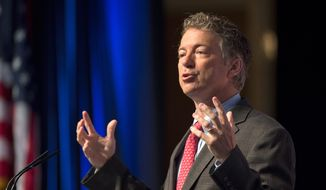** FILE ** Sen. Rand Paul of Kentucky said the U.S. should stay out of Iraq, and previous military action has emboldened extremists. (AP Photo/Molly Riley)