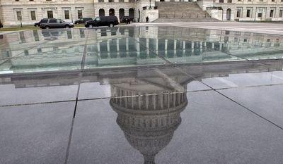 **FILE** The dome of the Capitol is reflected in a skylight of the Capitol Visitor's Center in Washington on  Jan. 1, 2013. (Associated Press)