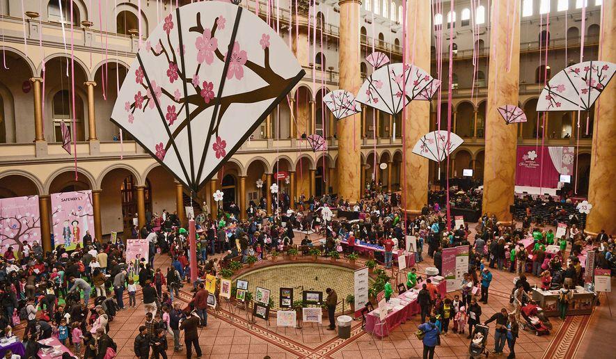 The three-story Great Hall at the National Building Museum lends itself to a wide variety of events and celebrations, such as the National Cherry Blossom Festival's Family Days in March 2013. (Andrew Harnik/The Washington Times)
