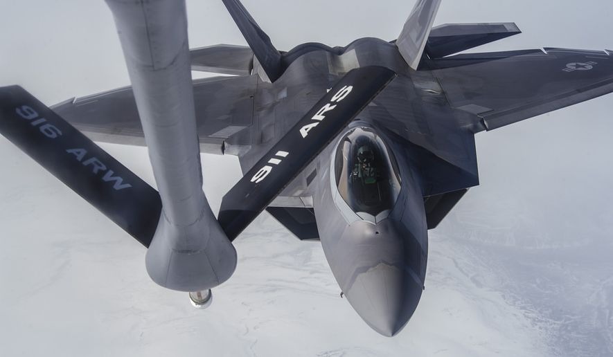 An F-22 Raptor pilot from Joint Base Elmendorf-Richardson, Alaska, approaches a KC-135 Stratotanker to be refueled May 19, 2014, over the Joint Pacific Alaska Range Complex. (U.S. Air Force photo)