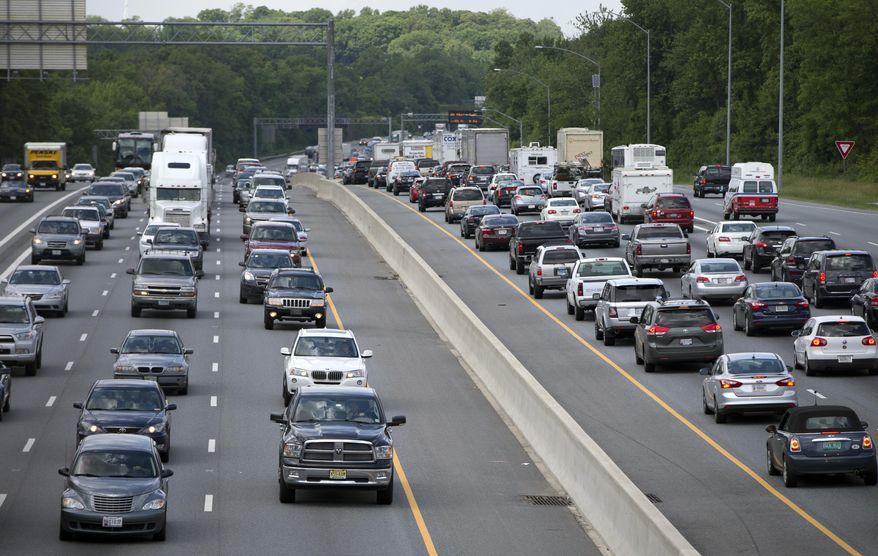 FILE - In this May 23, 2014 file photo, traffic moves on the Interstate 495, the Capital Beltway, in Hyattsville, Md., outside Washington. The Centers for Disease Control and Prevention released its latest drowsy driving report on Thursday, July 3, 2014. According to a new survey, about 1 in 25 adults say they recently fell asleep while driving. (AP Photo/Carolyn Kaster, File)