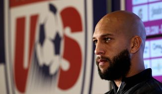 Goalkeeper Tim Howard, who made 16 saves for the U.S. team in the World Cup knockout round, credits God for his athletic abilities. (Associated Press)