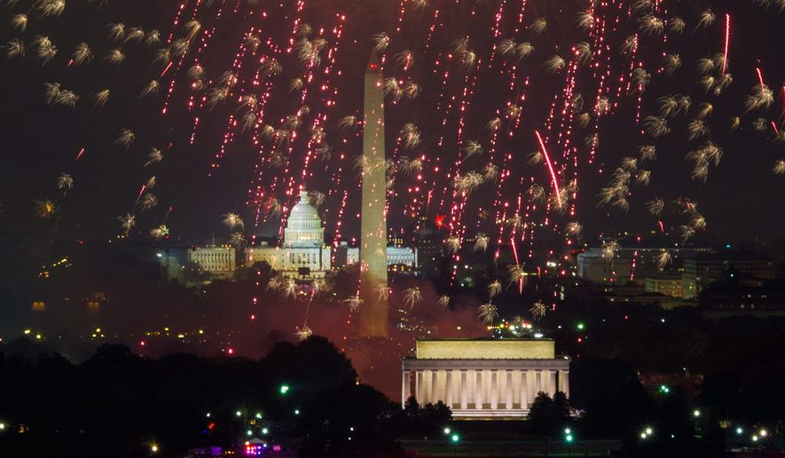 Fireworks can be seen from the Top of the Town as they explode over the National Mall to celebrate Independence Day, Arlington, Va., Wednesday, July 4, 2012. (Andrew Harnik/The Washington Times) (Andrew Harnik/The Washington Times)