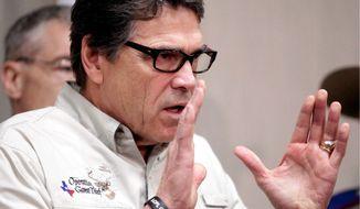 Texas Gov. Rick Perry said the border is less secure than in recent years and that the surge of minors crossing into the U.S. illegally has become a major distraction for immigration agents. (Associated Press)