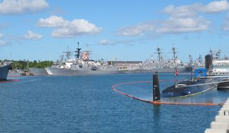Vessels sit docked at Pearl Harbor, Hawaii, during the the Rim of the Pacific naval exercises on Monday, June 30, 2014. (AP Photo/Audrey McAvoy)