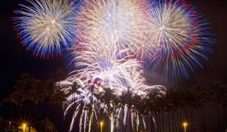 Fireworks fill the sky over Honolulu for the Independence Day celebration. Thousands of Oahu residents and visitors gathered at Magic Island and Ala Moana Beach Park to see the annual Fourth of July fireworks show.  (AP Photo/Eugene Tanner)