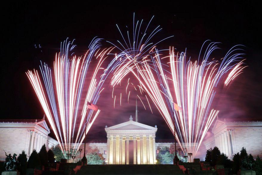 Fireworks explode over the Philadelphia Museum of Art during an Independence Day celebration, in Philadelphia. (AP Photo/Matt Rourke)