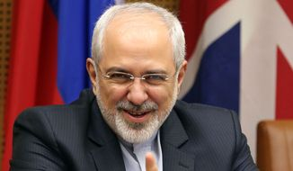 Iranian Foreign Minister Mohammad Javad Zarif waits for the start of closed-door nuclear talks with European foreign policy chief Catherine Ashton in Vienna, Austria, Thursday, July 3, 2014. (AP Photo/Ronald Zak)