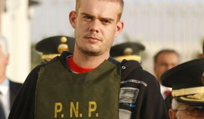** FILE ** Dutch citizen Joran Van der Sloot is escorted by police officers outside a police station in Tacna, Peru, near the Chilean border, on Friday, June 4, 2010. Peruvian police said on Tuesday, June 7, 2010, that Mr. Van der Sloot has confessed to killing Stephany Flores in his Lima hotel room on May 30. (AP Photo/Karel Navarro, File)