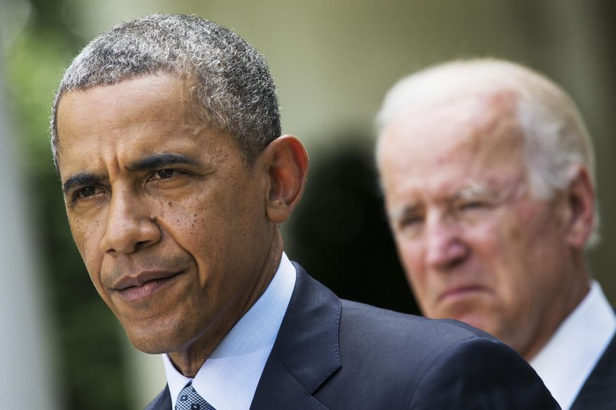 **FILE** President Obama, accompanied by Vice President Joe Biden, makes a statement about immigration reform on June 30, 2014, in the Rose Garden of the White House in Washington. (Associated Press)