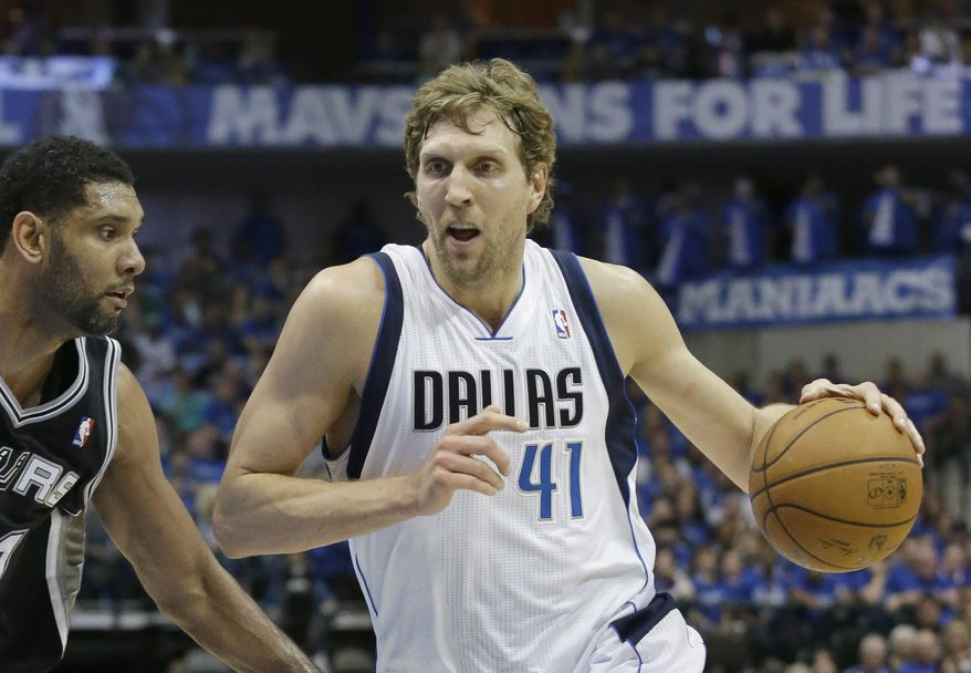 FILE - In this April 26, 2014 file photo, Dallas Mavericks forward Dirk Nowitzki (41) drives against San Antonio Spurs forward Tim Duncan during the first half of Game 3 of an NBA basketball first-round playoff series in Dallas. Nowitzki talks and acts like he's under contract with the Mavericks even when he's not. So while the signing of his fifth and possibly final deal with Dallas is a foregone conclusion early next month, the shape of things around the 36-year-old is the biggest question starting with the NBA draft Thursday night, June 26. (AP Photo/LM Otero, File)
