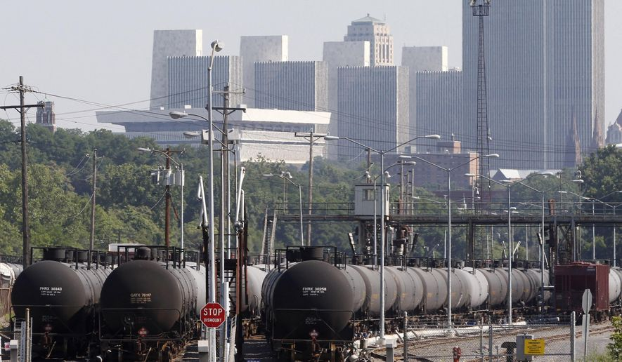 In this July 16, 2013, file photo, railroad oil tankers are lined up at the Port of Albany, in Albany, N.Y. While the federal government has ordered railroads to give states details about shipments of volatile crude oil from North Dakota's Bakken shale region, New York officials haven't decided whether to share that information with the public. (AP Photo/Mike Groll, File)