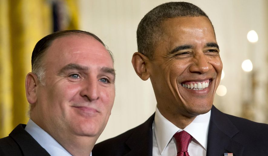 """President Barack Obama smiles with chef Jose Andres, after awarding the chef with a """"Outstanding American by Choice"""" award during a naturalization ceremony for active duty service members and civilians, Friday, July 4, 2014, in the East Room of the White House in Washington. Obama highlighted a positive side of the immigration debate by presiding over an Independence Day citizenship ceremony for service members who signed up to defend the U.S. even though they weren't American citizens. (AP Photo/Jacquelyn Martin **FILE**"""