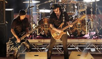 "** FILE ** In this Saturday, Oct. 7, 2006, file photo, rock band Motorhead performs during the show program of the the ""TV total Stock Car Crash Challenge 2006"" celebrities race at the Veltins-Arena in Gelsenkirchen, western Germany. (AP Photo/Martin Meissner, File)"