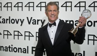 Hollywood actor, director and producer Mel Gibson holds the Crystal Globe for Outstanding Artistic Contribution to World Cinema at the opening of the 49th Karlovy Vary International Film Festival in Karlovy Vary, west Bohemia, on Friday, July 4. (AP Photo,CTK/Vit Simanek) SLOVAKIA OUT