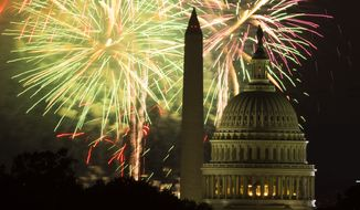 Fireworks illuminate the sky over the U.S. Capitol building and the Washington Monument during Fourth of July celebrations, on Friday, July 4, 2014, in Washington. (AP Photo/ Evan Vucci)