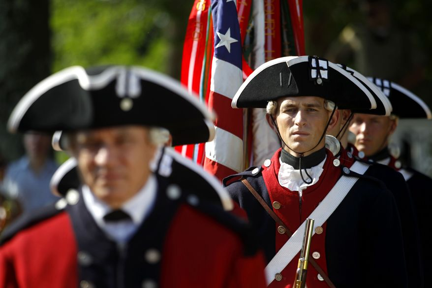 The United States Army Continental Color Guard and Old Guard Fife and Drum Corps prepare to present the colors during the annual Independence Day celebration and naturalization ceremony at Monticello in Charlottesville, Va. on Friday, July 4, 2014. (AP Photo/The Daily Progress, Ryan M. Kelly)